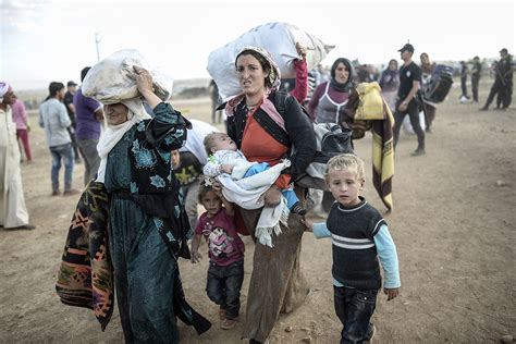 Fleeing Isis: Tens of Thousands of Syrian Kurds Cross