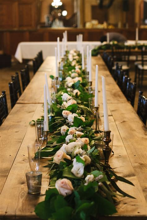 Wooden Farm Table With Garland Centerpiece