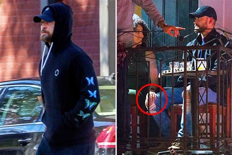 Married Justin Timberlake looks stony-faced after holding