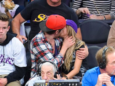 Sarah Hyland and Dominic Sherwood captured on kisscam   HELLO!