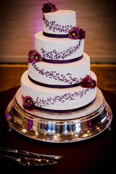 Ivory Wedding Cake with Purple Flowers