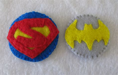 batgirl and superman hair clip by K-n-B-creations on